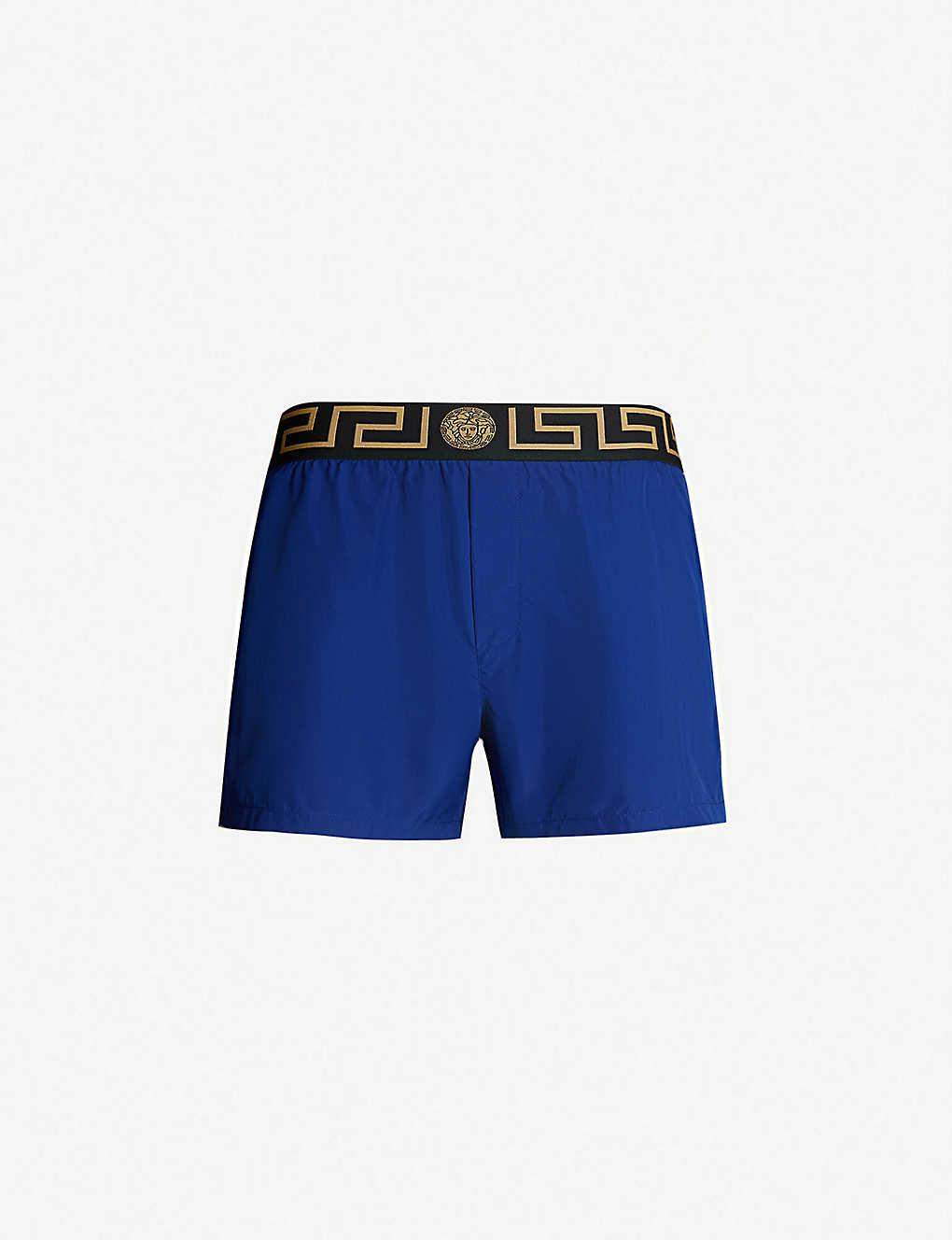 9cfae508d0 VERSACE - Iconic swim shorts | Selfridges.com