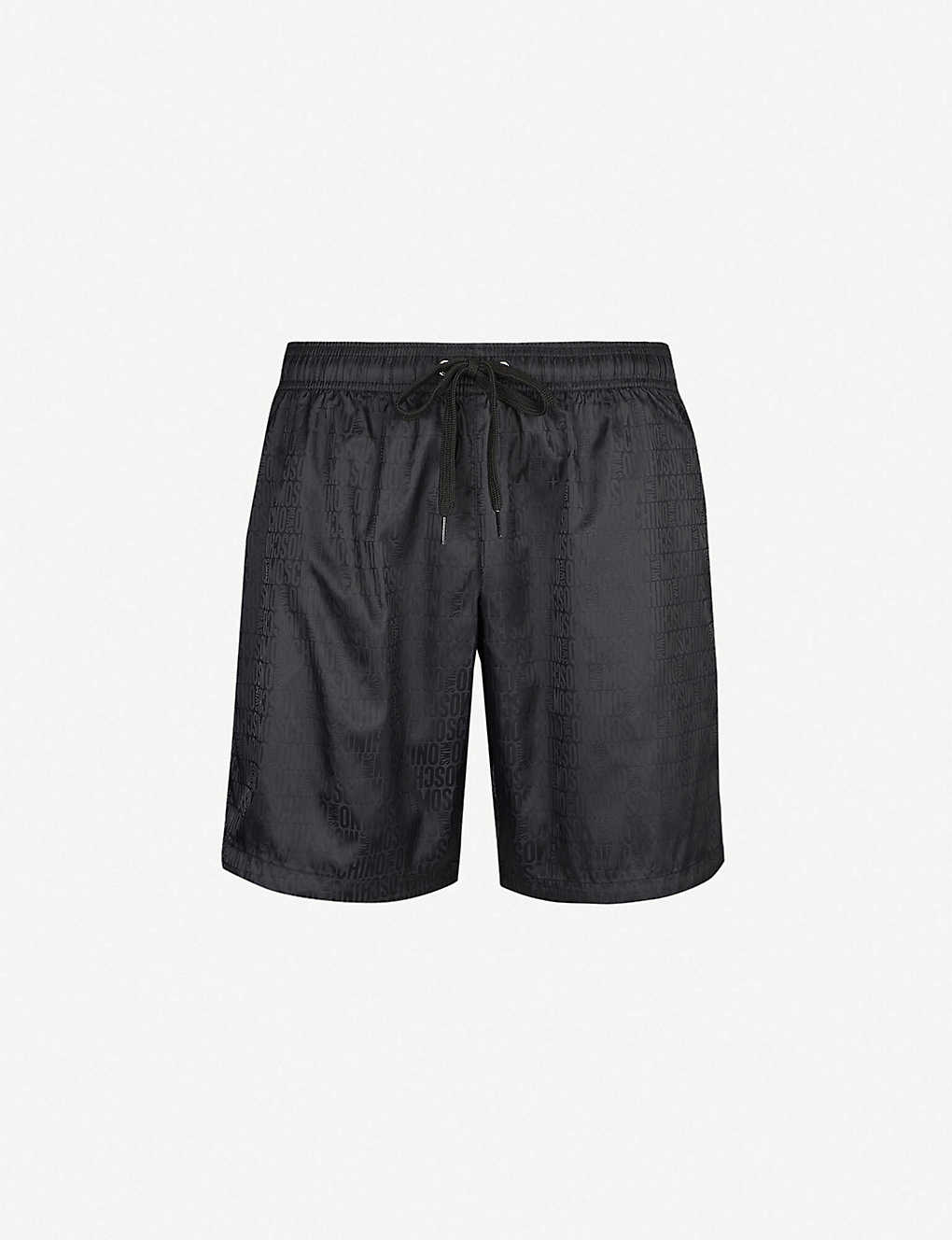 8ef8d390d2143 MOSCHINO - Tonal logo-print swim shorts | Selfridges.com
