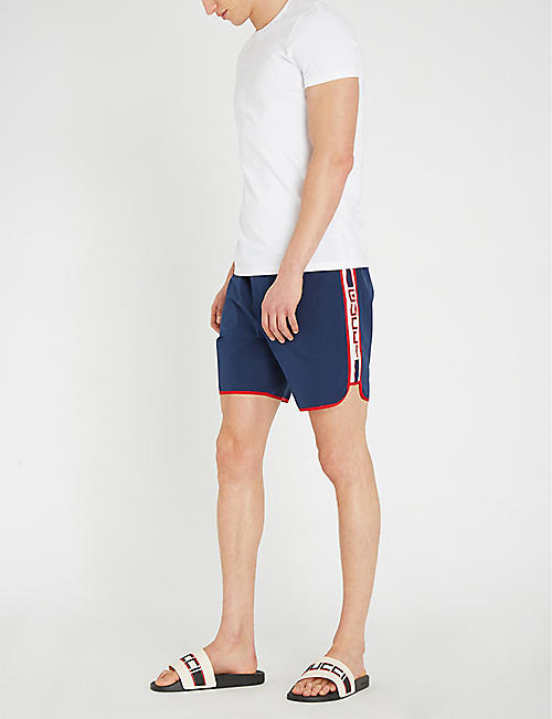 51fcbf806eaf5 GUCCI Logo-taped side relaxed-fit swim shorts