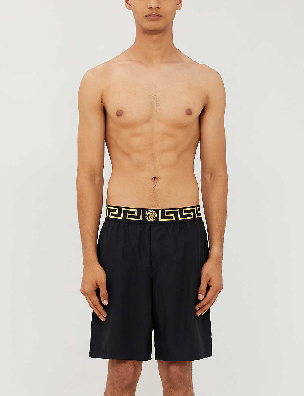 VERSACE: Iconic branded swim shorts