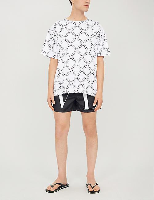 9d7bf284ed VALENTINO Relaxed-fit logo-print swim shorts