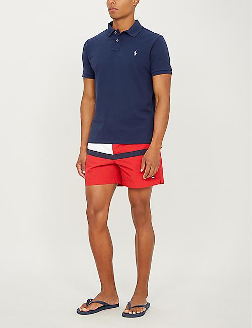 ff7b4fe9 TOMMY HILFIGER Logo-print relaxed-fit swim shorts.