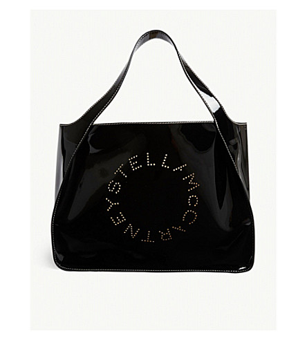 69d7412329cc STELLA MCCARTNEY Perforated logo patent faux-leather tote (Black