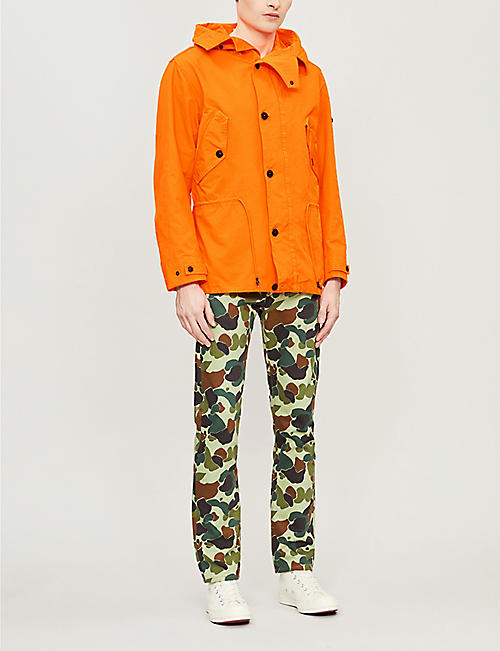 JUNYA WATANABE Junya Watanabe x Commes des Garçons x Levi's camouflage-print slim-fit tapered jeans