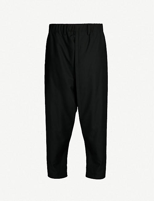ISSEY MIYAKE Tapered dropped-crotch wool-poplin trousers af21c4c169