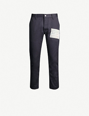 ENFANTS RICHES DEPRIMES Logo-patch slim-fit tapered cotton trousers