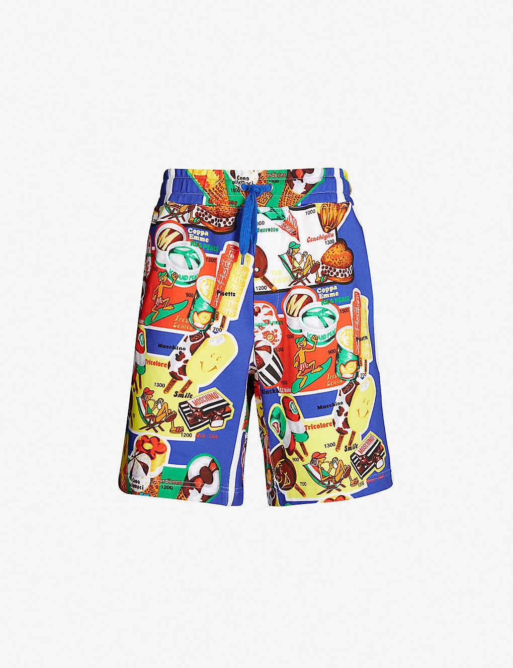 f33e2890f4 MOSCHINO - Graphic printed cotton-jersey shorts | Selfridges.com