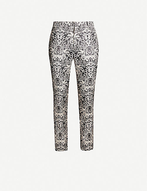 ALEXANDER MCQUEEN Lace-print slim-fit crepe trousers