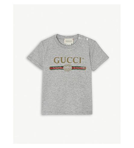 1235381c231 GUCCI - Distressed logo-print cotton T-shirt 3-36 months ...