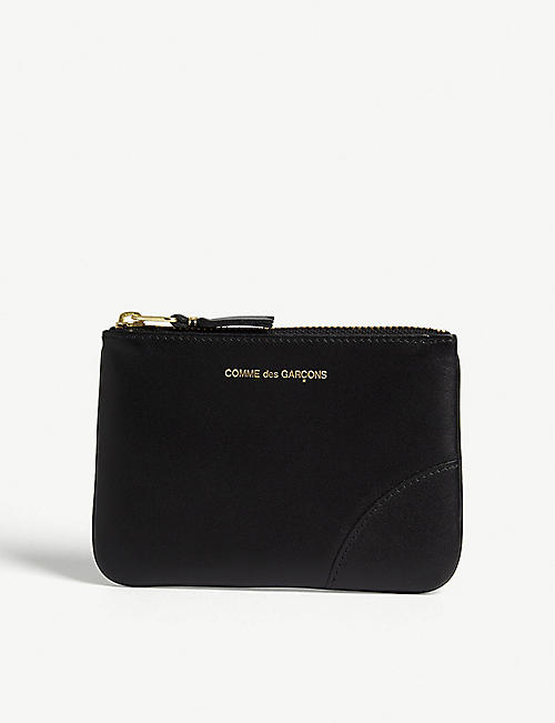 COMME POCKET Logo embossed leather zip top pouch