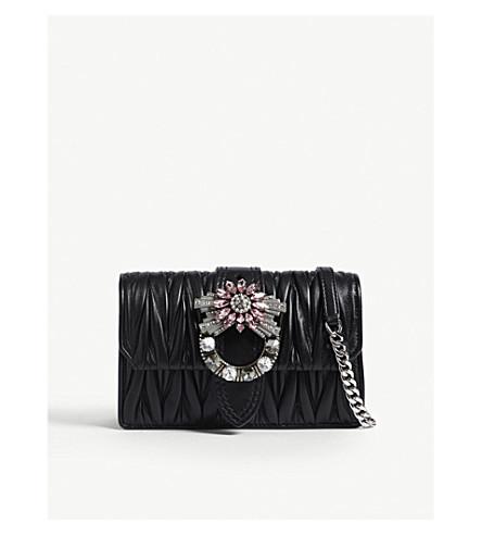 a3e5d2583a79 ... MIU MIU Matelassé leather embellished buckle cross-body bag (Black.  PreviousNext