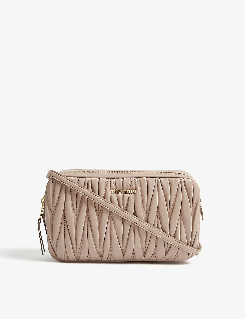 69c17617e473a MIU MIU - Matelassé leather cross-body bag