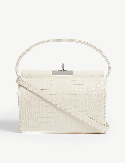 GU DE: Croc-embossed leather bag