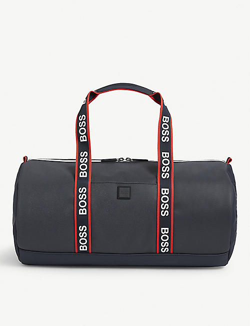 BOSS: Brand-embossed shell holdall
