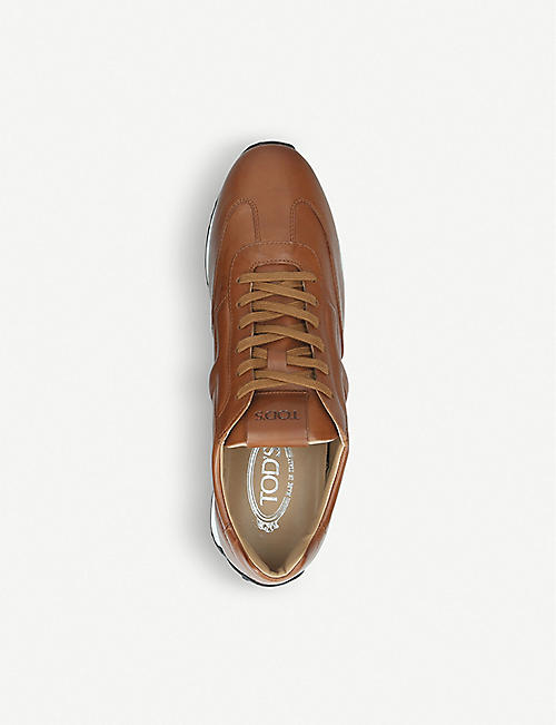 TODS Embossed logo leather running trainers
