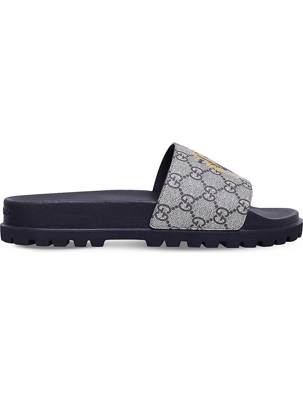 d5668878d7b4 GUCCI - Pursuit tiger-print canvas slider sandals