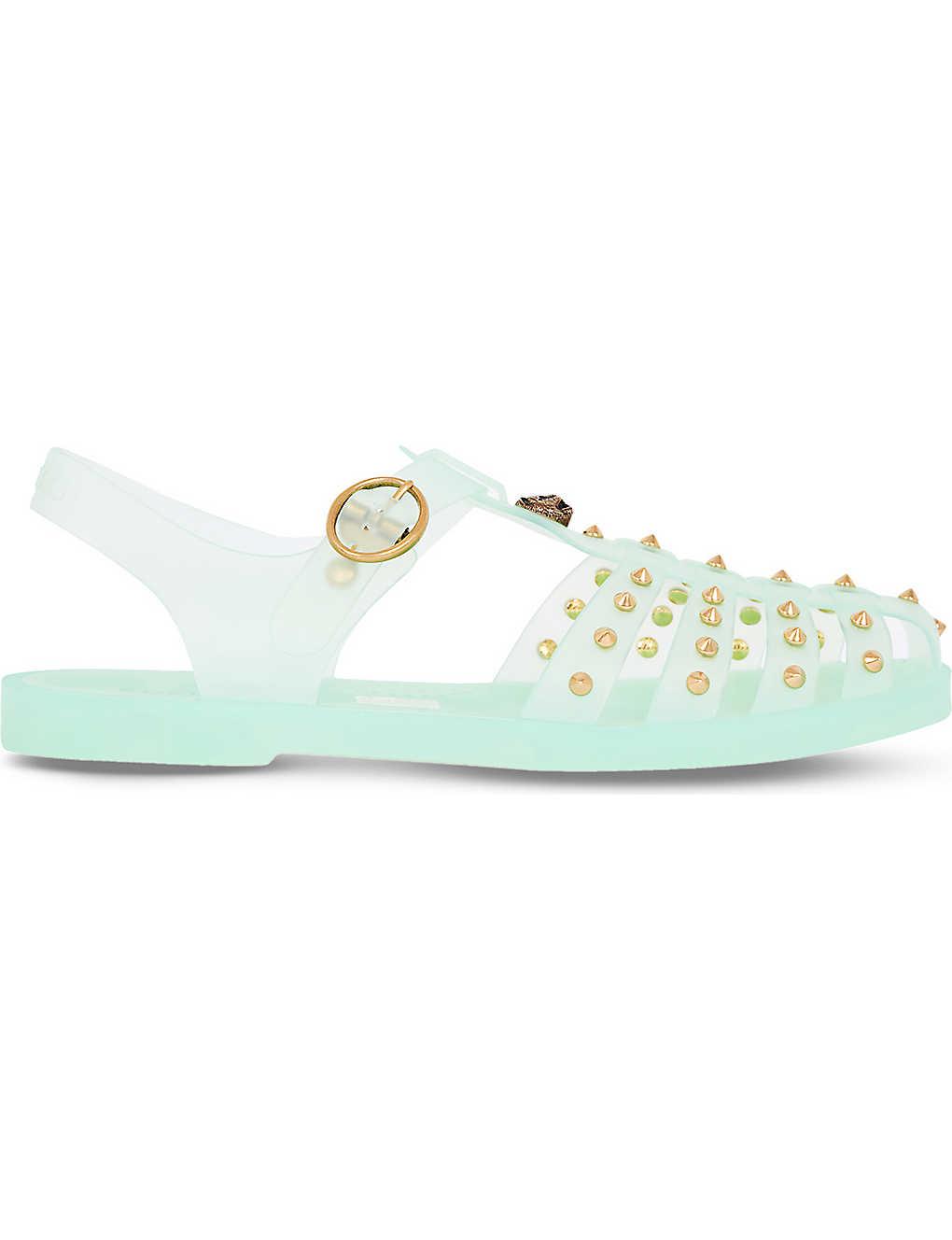 497251109 GUCCI - Glossy stud jelly sandals | Selfridges.com