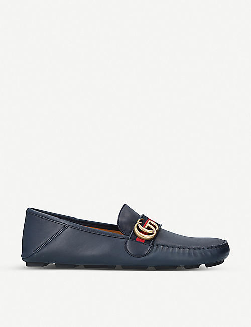 GUCCI: Driver logo-embellished leather loafers