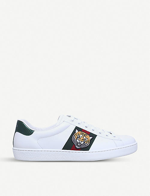 low priced ee0f5 cb4d8 GUCCI New Ace tiger-embroidered leather trainers