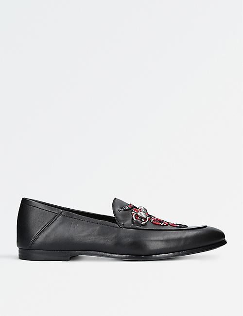 a833bba10d2 GUCCI - Kingsnake leather loafers