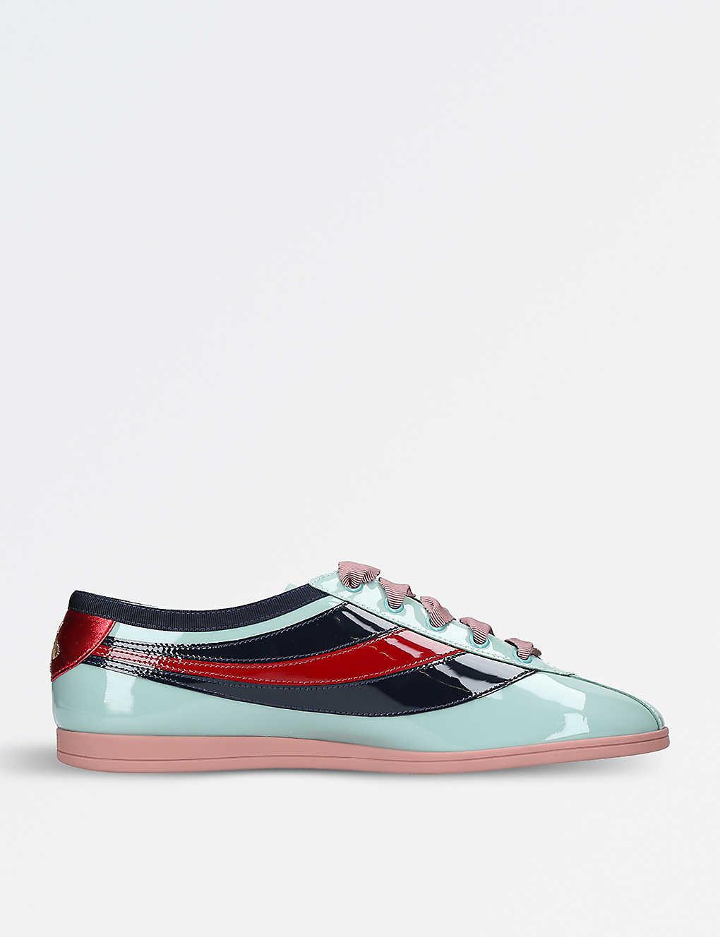8e55c8092 GUCCI - Falacer patent leather sneakers | Selfridges.com