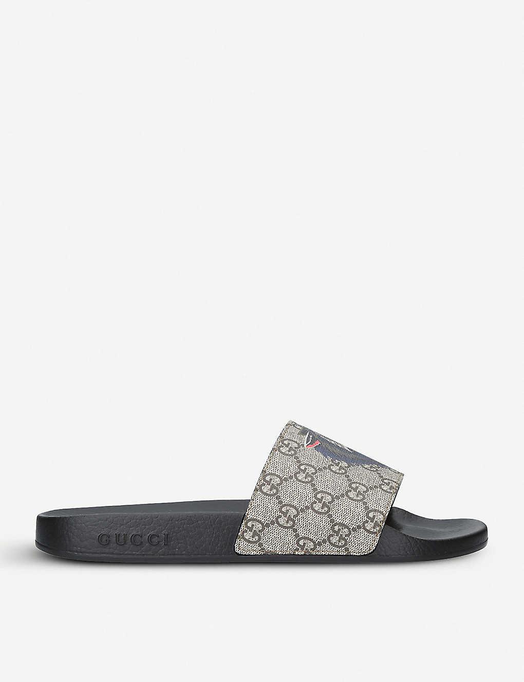 a6935404f8 GUCCI - Supreme wolf-print canvas slider sandals | Selfridges.com