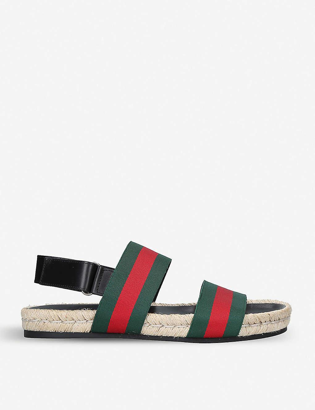 a5e021561 GUCCI - Juan Web-striped leather and canvas sandals | Selfridges.com