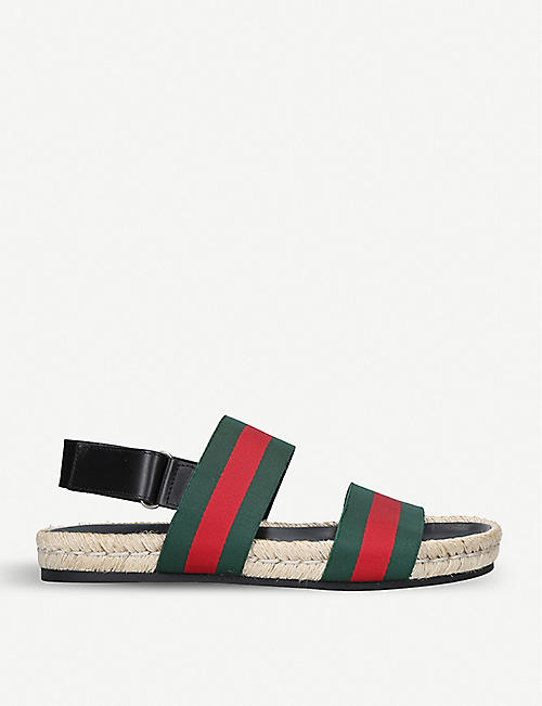 a561d52fded GUCCI - Juan Web-striped leather and canvas sandals