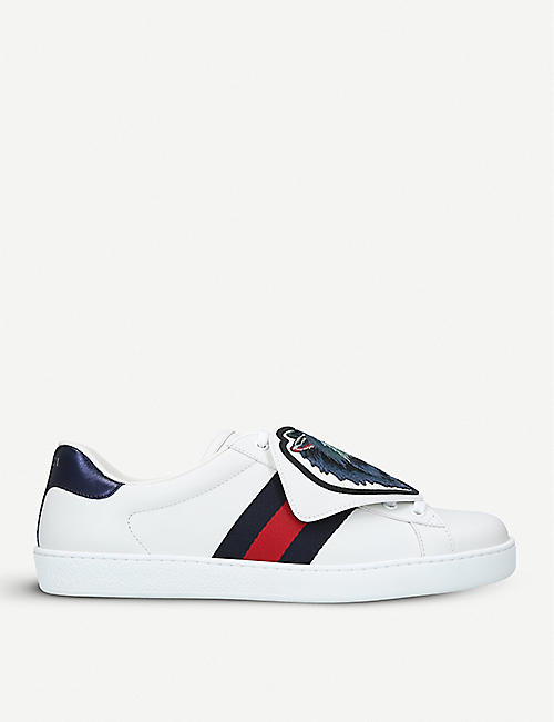 96b03270eea GUCCI - New Ace wolf-patch leather trainers