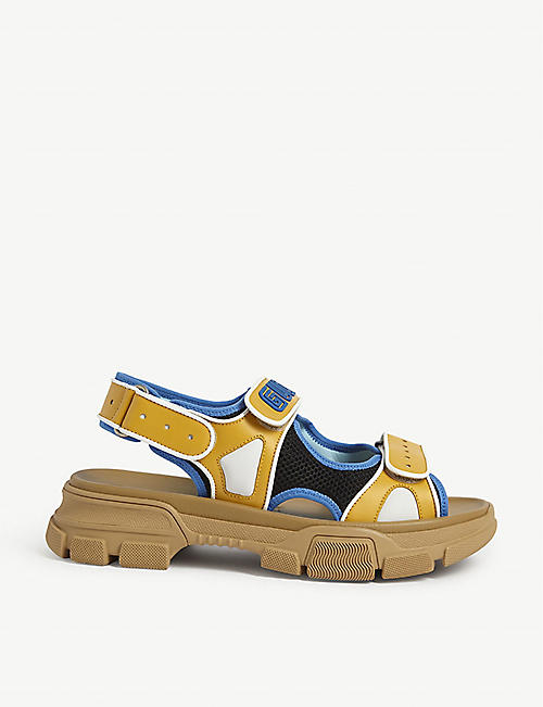GUCCI: Aguru Trek brand-embellished leather gladiator sandals