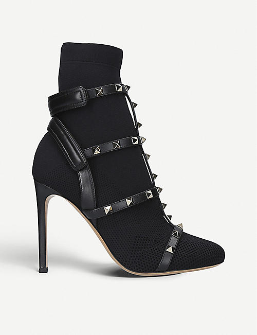658025fe011 VALENTINO Rockstud Bodytech knitted and leather boots