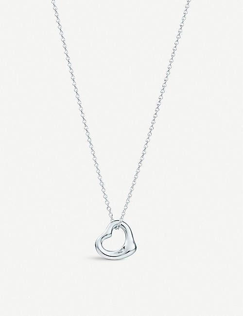 14981862bc TIFFANY & CO - Elsa Peretti® Open Heart pendant in sterling silver |  Selfridges.com