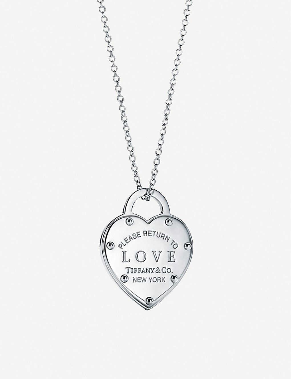 32a062c5c5 TIFFANY & CO - Love Lock sterling silver pendant | Selfridges.com