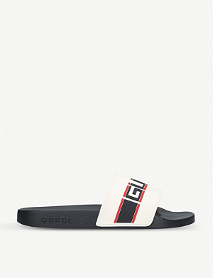 GUCCI Logo-embossed rubber sliders