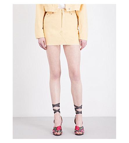 b465c3a8c2 ... TOPSHOP MOTO denim mini skirt (Yellow. PreviousNext