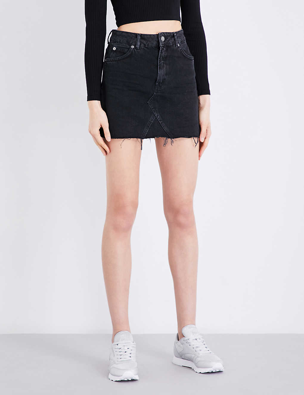 b6a0cfcdf TOPSHOP - Frayed-hem high-waisted denim mini skirt | Selfridges.com