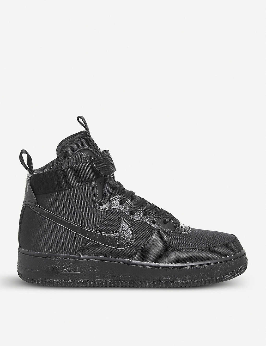 ed1142f2e0d NIKE - Air Force 1 high-top canvas and leather trainers