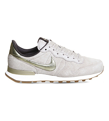 super popular 7ea40 064b9 nike internationalist grey gold