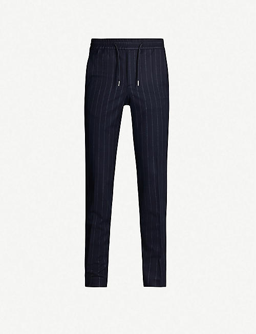 SANDRO Pinstriped tapered stretch-wool trousers