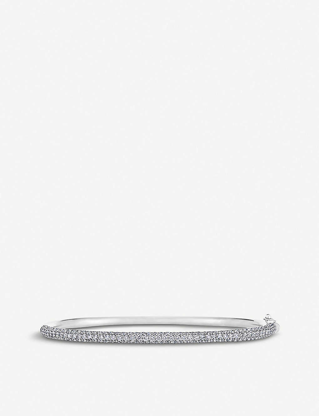 DE BEERS: Three row 18ct white-gold and diamond micropavé bangle
