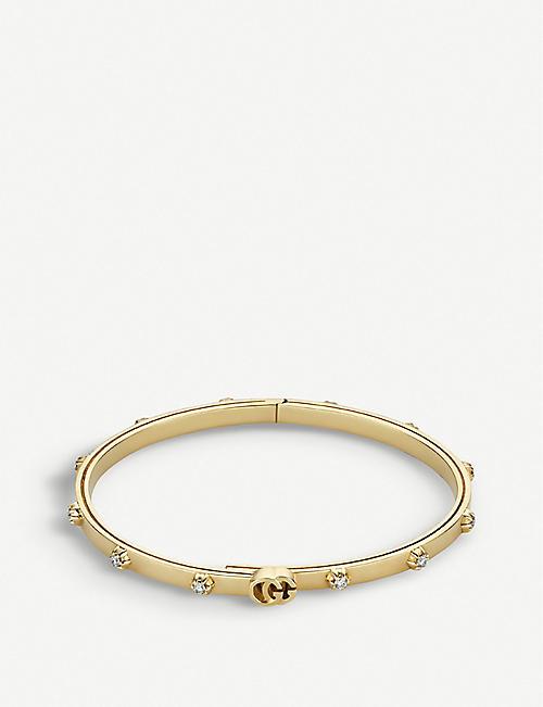 73f07ccf564 GUCCI GG Running 18ct yellow-gold and white diamond bracelet