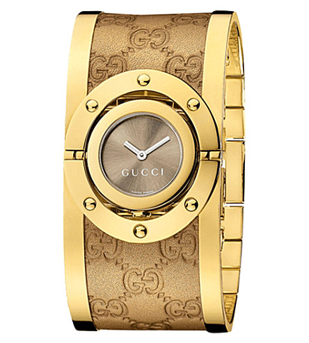 826819362f3 GUCCI YA112434 Twirl yellow gold plated stainless steel cuff watch ...