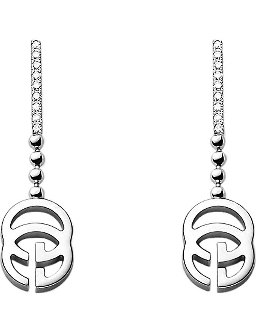 5a9acc63f GUCCI - Running G 18ct white-gold and diamond earrings | Selfridges.com
