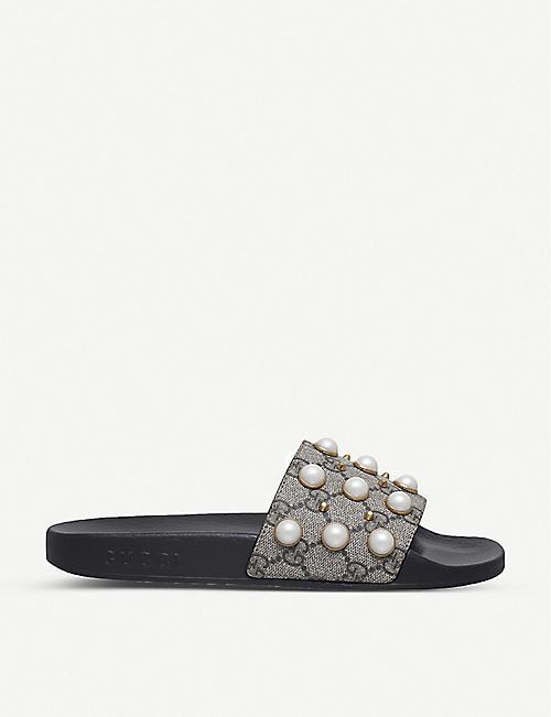 573f5a2dfde7 GUCCI Pursuit pearl-embellished rubber slider sandals