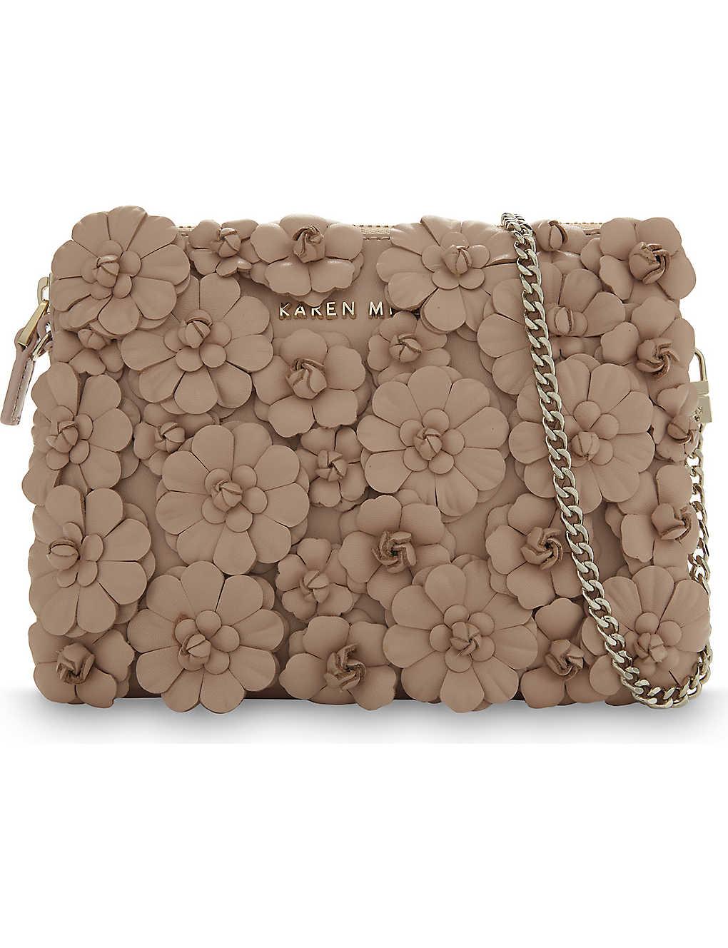 54b80638d87d KAREN MILLEN - Floral leather clutch | Selfridges.com