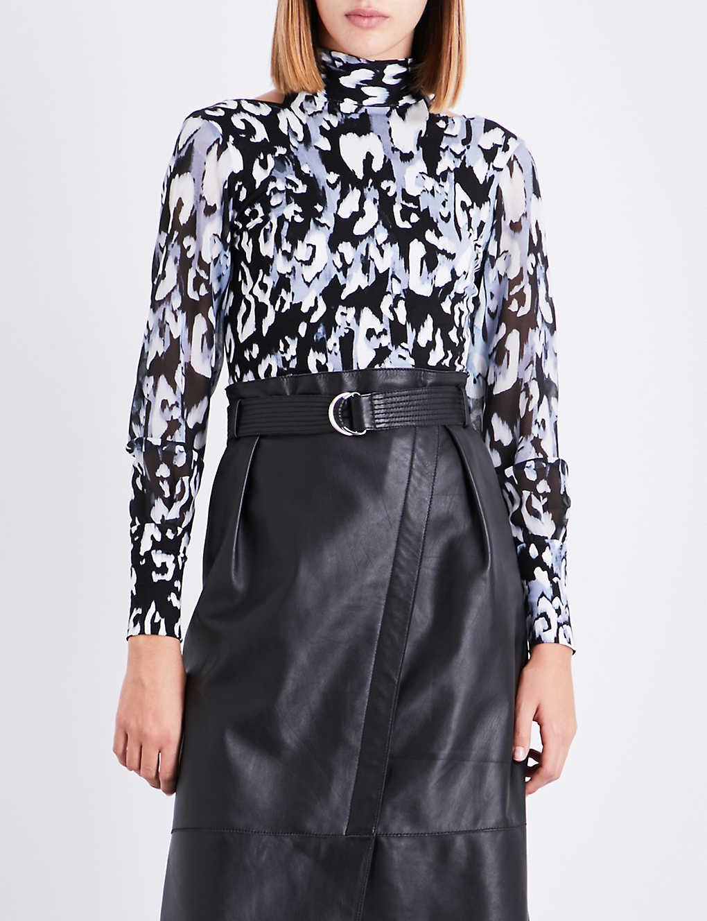 955251f1e55 KAREN MILLEN - Leopard-print tie-neck jersey top | Selfridges.com