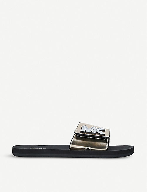 26d2bed75 Rockstud rubber sandals. £220.00. MICHAEL MICHAEL KORS Logo-embellished  metallic sliders