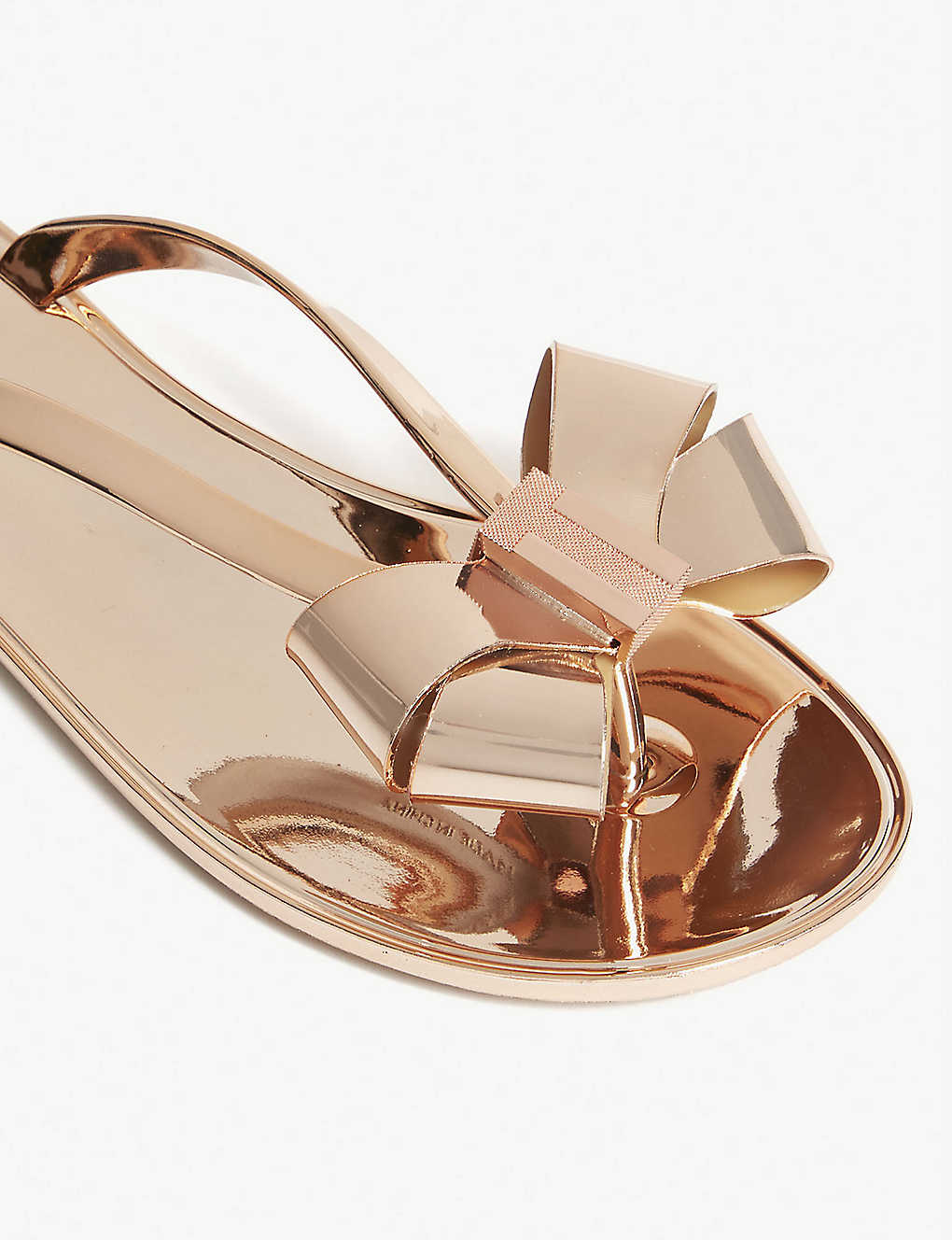 2a2ff4f34c6c TED BAKER - Glamari bow-detail metallic jelly sandals