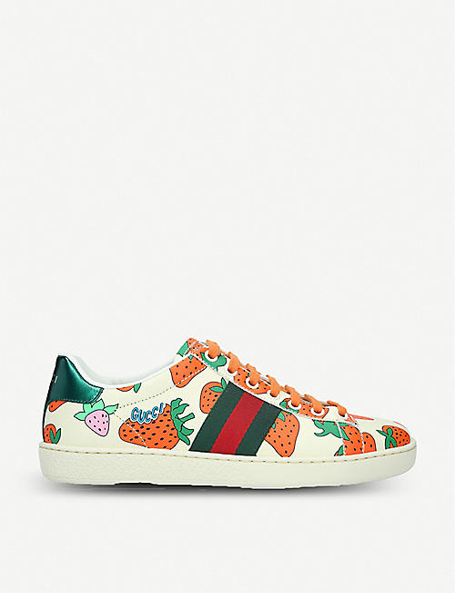 2a7a8b682b41 GUCCI New Ace strawberry-print leather trainers