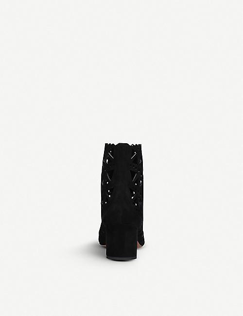 692f51de627e2 AZZEDINE ALAIA Laser-cut suede heeled boots. Quick Shop